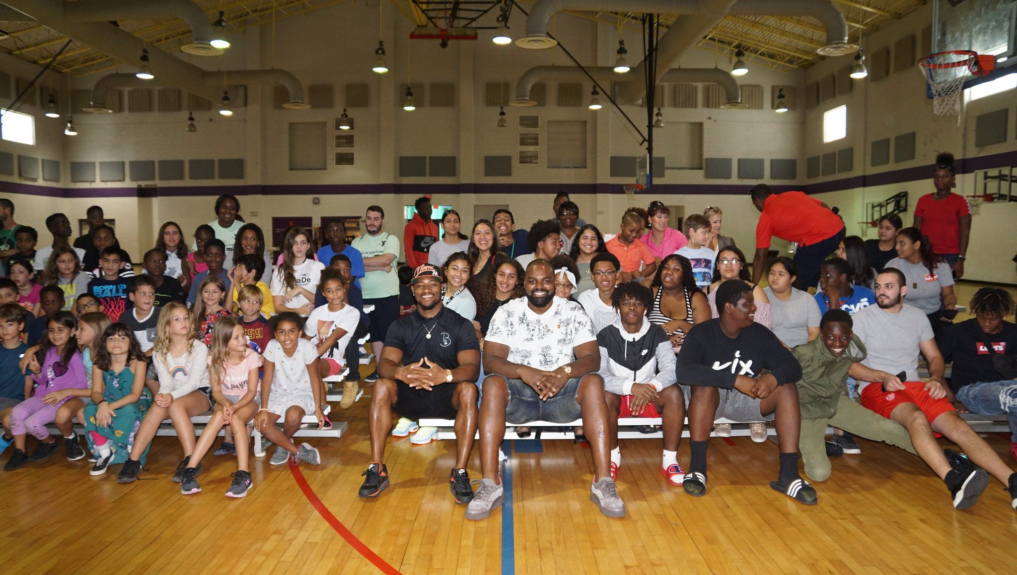 FORMER NFL PLAYERS MICHAEL OHER & JAMARCA SANFORD PARTNER WITH THE YMCA TO PROVIDE SCHOOL SUPPLIES, MOTIVATIONAL MESSAGE TO YOUTH IN HOMESTEAD AREA